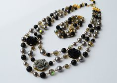 These necklace and bracelet are made of black and gray pearl and crystal beads, rose flowers, gold plated filigree, chain and clasp. The set