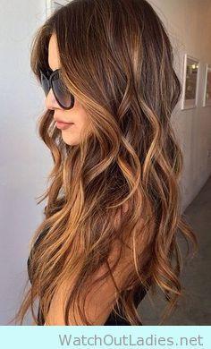 Long hair with beach waves with caramel highlights