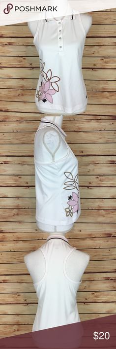 """Athleta White Floral Racerback Collared Tank Top S Athleta tank top. White with pink and brown accents. Floral appliqué. Collared. Racerback. Snap closures at neckline. Small.  Excellent preowned condition with no flaws.  Measurements are approximately: 34"""" bust, 33"""" waist, and 22.5"""" length.  100% polyester.  No trades. All items come from a pet friendly home. Bundle to save! Athleta Tops Tank Tops"""