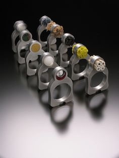 """Wonderful rings as a Thesis project by Angela Kuyers  """"Sustainable Minds Rings""""  using EDM cut aluminum and found materials."""