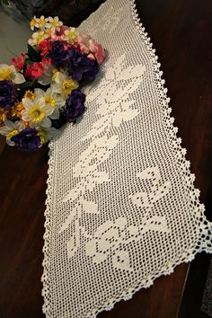 This beautiful table runner is made from white cotton thread #10. This elegant design will look beautiful on any table or it will make lovely gift for