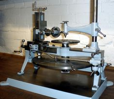 "An early horological gear-cutting machine from around 1900 and probably made in Germany or Switzerland. The dimensions of the machine - the largest diameter accommodated being 268 mm - indicate that it would have been used to produce gears (""wheels"" in clock-making terms) for domestic timepieces. The  dividing plate is 320 mm in diameter with 29 circles of holes from 58 to 360 - including all tooth numbers up to 50 and some over 50 that can obtained by division"
