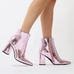 This boot is a PD office hero! Featuring a flared block heel and pointed toe in a high shine liquid metallic. Sits just on the ankle so perfect paired with dresses  and jeans alike!   Heel Height: 3.6\