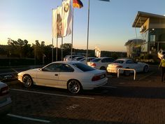 Pictured at a BMW dealer with all the modern white cars!! at sunset!!
