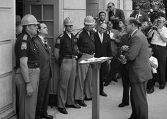 Attempting to block integration at the University of Alabama, Governor George Wallace stands defiantly at the door while being confronted by Deputy U.S. Attorney General Nicholas Katzenbach. http://www.payscale.com/research/US/School=University_of_Alabama_-_Main_Campus/Salary