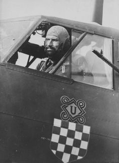 Fly Boys - The pilot in the cockpit Croatian German-made Dornier bomber from the Croatian Squadron Bombardment Squadron Luftwaffe (Kroatische) / KG As part of 'Croatian Air Legion' (Hrvatska zrakoplovna legija) this air unit was called the Bomber Group. Luftwaffe, World History, World War Ii, Ww2 Aircraft, Nose Art, Military History, Troops, Wwii, Catholic