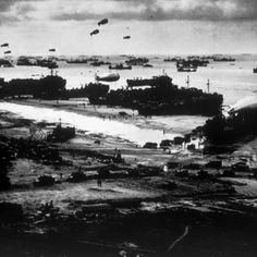 Allied Ships Landing Military Supplies on Omaha Beach after the D-Day Invasion, 1944 r