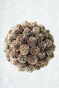 """DIY Craft - pinecone """"kissing ball"""" - use styrofoam ball, glue on cones, frost with spray """"snow"""", insert hanger Noel Christmas, All Things Christmas, Winter Christmas, Christmas Ornaments, Christmas Pine Cone Crafts, Christmas Wedding, Diy Ornaments, Christmas Fashion, Ball Ornaments"""