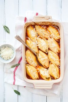 """Pumpkin and Ricotta Stuffed Shells. These stuffed shells are simple, and while they don't taste quite as strongly of pumpkin as a dish titled """"pumpkin stuffed shells"""" should. Think Food, I Love Food, Good Food, Yummy Food, Tasty, Pumpkin Recipes, Fall Recipes, Baked Pumpkin, Pumpkin Pasta"""