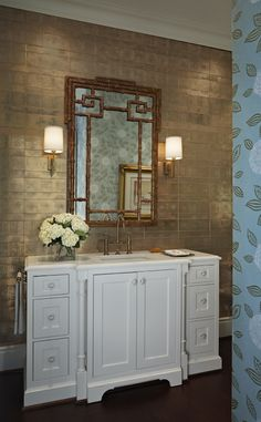 Gorgeous bathroom with gold metallic wallpaper and bamboo mirror