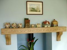 The traditional Oak Mantle Shelf with Corbels is constructed as a box machined from 1 inch kiln dried timber boards giving the appearance of one Oak Beam Fireplace, Oak Mantle, Cottage Fireplace, Mantle Shelf, Living Room With Fireplace, Fireplace Mantles, Oak Shelves, Floating Shelves, Shelving