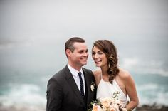 The bride and groom dressed up and eloped down to the coast of California for their wedding day. Sporting a traditional wedding day look for cooler weather conditions, the groom wore a dark gray suit with a patterned navy and white tie and simple white boutonniere.