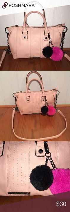 NWOT Steve Madden purse/cross body NWOT. Can be worn as a purse or crossbody. Comes with the two Pom Pom keychain. Great light pink color for spring and summer! Steve Madden Bags Crossbody Bags
