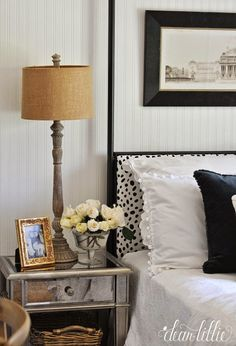 For a fun spring refresh we recovered our headboard with an unexpected black and white dalmatian print fabric and added some black velvet pillows and other fun accessories from @homegoods. (sponsored pin)
