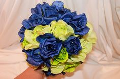 Navy blue and lime green bouquet with matching boutonniere