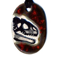 Surly Ramics Dinosaur Fossil Ceramic Necklace in Brown and Red. $18.00, via Etsy.