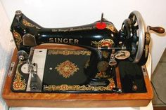 Singer 128: this is what mine is, though with an attached motor and no cool wooden handle.  Mine is from 1923.