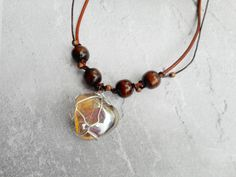 Homemade necklace genuine leather straps by Liesbeth Visscher at JHFWBeadsAndFindings on #Etsy                                                                                                                                                                                 More