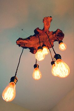 Olive Tree Light Fixture with Cascading Edision Bulbs! Earthy, rustic yet modern, contemporary addition to a #foyer, #kitchen, #office space or even a #bedroom. For custom light designs email Paul@7mwoodworking