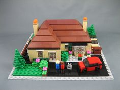 Super cute micro build of a house - love the roof!    Another mini LEGO house, via Flickr.