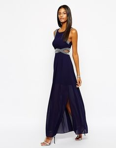 TFNC Maxi Dress With Embellishment and Cut Out Detail - navy.   The bling on the dress means that you can actually get away with wearing no jewelry and still look great.   Combine with a pair of silver strappy sandals and you'll be the 'belle of the ball'   If you do want to wear jewelry stick with classics like a tennis bracelet or thin silver bangle and some silver drop ear-rings - forget the necklace as it will detract too much from the dress.