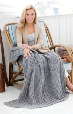 Cabled & Shell Throw Crochet Pattern - This fascinating stitch pattern features a cable and shell for interesting texture and warmth. Crocheted in one color, it is perfect if you prefer not to have seaming to do to finish your throw.