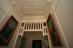 Original ornate ceiling and cornices in this Californian Bungalow.