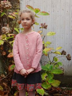 A girl's cardigan with shell stitch