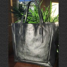 """HPBlack Leather Luxe Tote w Brass Corners HOST PICK for the Work Week Chic Party!   NWT Coach Black Leather Luxe Tote.  Inside zip, cell phone & multifunction pockets. Fabric lining. Latch closure.  Measurements: 15"""" (H) x 18"""" (L at top, tapered at bottom) x 3.5"""" (W) No Trades & No PayPal  Coach Bags Totes"""