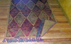 faux carpet with turned-up corner painted on floor Painted Rug, Painted Floors, Floor Cloth, Floor Rugs, Gypsy Caravan, Diy Flooring, Glamping, Carpet, Murals