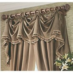 Taupe panels w/ attatched taupe fringed ring hung Valance
