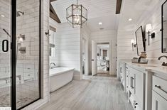 Welcoming craftsman style home with farmhouse touches in Arkansas This beautiful craftsman style home was designed by Celtic Custom Homes, located along Clear Creek in Fayetteville, Arkansas. Shiplap Bathroom Wall, Blue Bathroom Decor, Bathroom Layout, Bathroom Styling, Bathroom Interior Design, Master Bathroom, Shiplap Ceiling, Washroom, Bedroom Decor