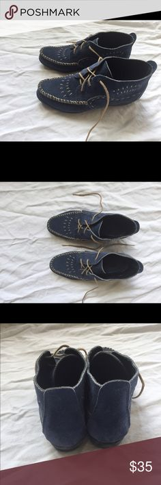 Minnetonka Moccasins Adorable blue embroidered Minnetonka Mocs in a size 6. Minimal wear. Minnetonka Shoes Ankle Boots & Booties