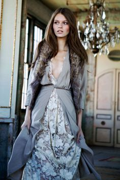 fur vest with neutrals and long dress