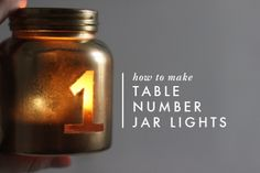 DIY Table Number Jar Lights - would also be cute with initials or married couple if no seating arrangement