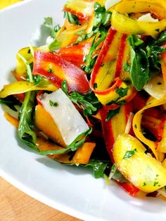 CARROT SALAD rainbow carrot ribbons baby arugula Parmigiano Reggiano ribbons slivered red onion fresh parsley fresh basil toasted pine nuts, optional salt and pepper to taste light vinaigrette, recipe below Instructions