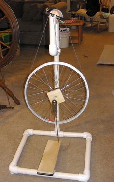 I'm going to have a crack at making a spinning wheel. Mum and me went on a little spinning course a few weeks ago and I now really want to learn. Also…my inner gromit hasn't had a… Diy Spinning Wheel, Spinning Wool, Hand Spinning, Spinning Wheels, Diy Carnival Games, Inkle Weaving, Card Weaving, Pvc Projects, Weaving Projects