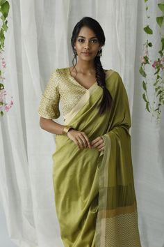 Olive green mixed beige saree is ideal for a day special occasion. Style this saree with your statement gold jewelry to complete this look. This saree comes with a beige contrast woven jacket with intricate weaving mixed with metallic tread, which gives a luxurious look to the saree.