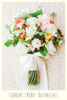Coral, yellow, pink and white simple hand tied bouquet with ribbon.