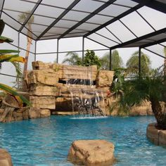 This small faux rock waterfall kit is our 28 Inch Waterfall on a pondless application. This waterfall is very versatile and may also be installed on a swimming pool or pond. Swimming Pool Waterfall, Indoor Swimming Pools, Swimming Pool Designs, Rock Waterfall, Indoor Waterfall, Backyard Pools, Outdoor Pool, Indoor Outdoor, Pool Enclosures