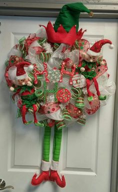 The elf on the shelf buddies have come to adorn your door. Made of deluxe mesh in red, green, and white. This cute holiday wreath is sure to be a big hit. 79.99