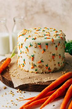 This is the BEST carrot cake recipe! It has an extra rich and moist texture that is perfectly spiced. This cake is then smothered in cream cheese frosting and adorned in frosting carrots. It's bound to be your new go-to carrot cake recipe. #carrotcake #cake #carrotcakerecipe #easterdessert #butternutbakery | butternutbakeryblog.com