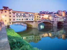 """Ponte Vecchio """"Old Bridge"""" Florence, Italy. The stores above use to be butchers, but now are occupied by jewelers, souvenir shops and art dealers."""