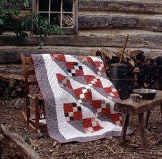 log home...wood bench/table honed..butter churn beautiful quilt..rocker