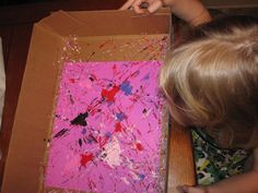 a box lid, paper, a few drops of paint and roll a few marbles around. almost as mess free art as you can get. was a great activity for her art birthday party too!