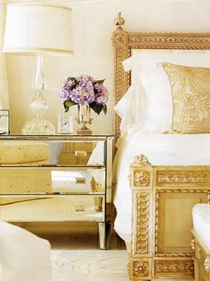 golden tones and a mirrored bedside table..  #bedroom décor, beds, headboards, four poster, canopy, tufted, wooden, classical, contemporary bedroom, nightstand, walls, flooring, rugs, lamps, ceiling, window treatments, murals, art, lighting, mattress, bed linens, home décor, #interiordesign bedspreads, platform beds, leather, wooden beds, sofabed