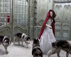 Not so 'little' anymore, Red Riding Hood bought her pack with her.  While she danced in the Ballroom, they howled in kennels.  Dark fairytales by Eugenio Recuenco