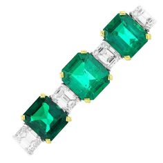 15.55 Carat Colombian Emerald Diamond Platinum Bracelet. Platinum flexible alternating bracelet consisting of 12 Colombian emeralds with a total carat weight of 15.55 carats and 21 diamond with a total carat weight of 10.65 carats. 21st century