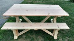 Unfinished trestle style farmhouse table with matching bench