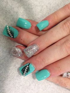 Glitter Feather Nails. Very pretty! I have to say, I am really into this feather design.